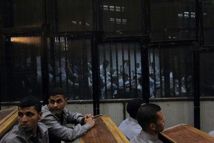 Egyptian court sentences 11 fans to death more than soccer riot