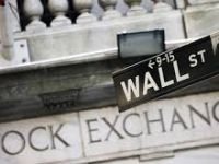Wall Street closes higher as oil prices soar